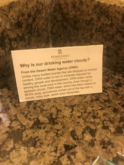 On the bath vanity was a sign which explained that their cloudy water was a result of the natural minerals in their water